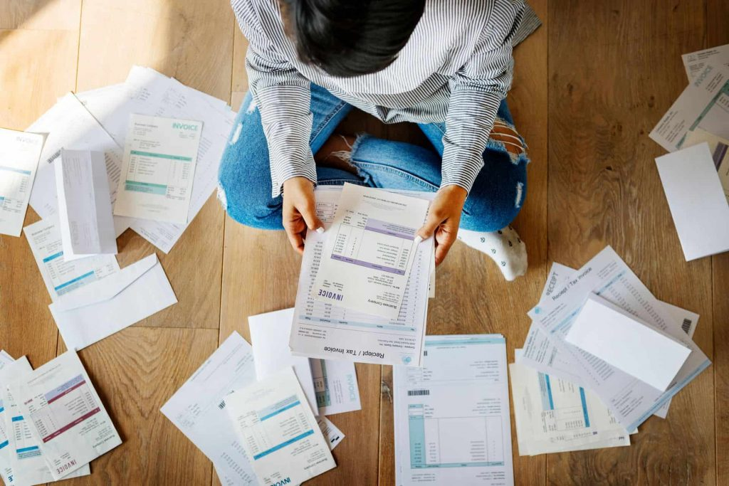 man reading documents for tax return